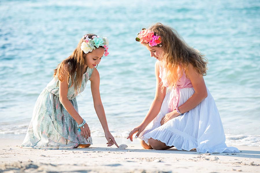 Two girls playing on the Dibai beach