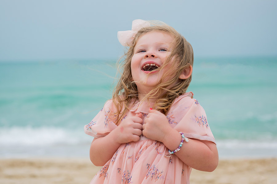 Smiling girl on the beach photo shoot in Abu Dhabi