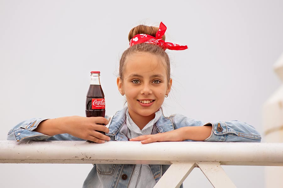 Smiling girl with a soda photo set in Abu Dhabi
